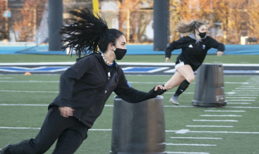 Amanda DaSilva, an engineering cooperative junior, runs during a soccer drill Thursday evening. The women's soccer team will start its season March 2 and the first home game will be on March 5 against Morehead State.