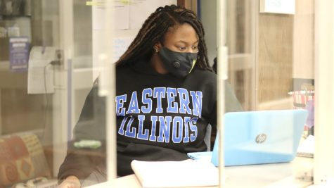Jennea Genard, a sophomore pre-nursing student and Andrews Hall desk assistant, working on her laptop Thursday evening while working the desk. .