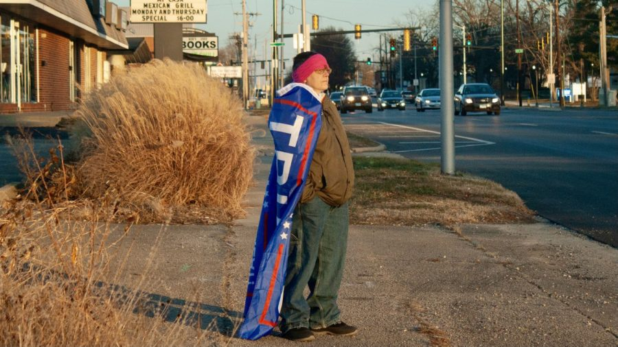 Bridgette Price stands on Lincoln Avenue on Wednesday afternoon in protest of Joe Biden's inauguration as president.