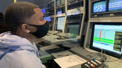 "Troy Clark II, junior sports media relations major, works in the control room during Newswatch Thursday evening. ""Hopefully by the end of the semester I could do some more sportswriting... do some sports reporting as I get more comfortable with the program,"" Clark said, looking forward to advancing in Newswatch."