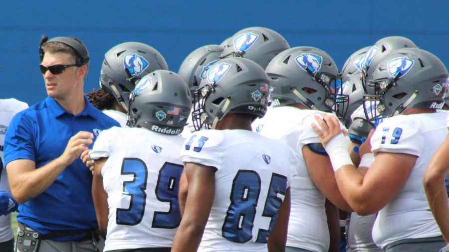 Eastern head football coach Adam Cushing addresses the team during a timeout in a game against Indiana State in September 2019. Cushing spoke with the media Tuesday as preparations for the upcoming season get underway.