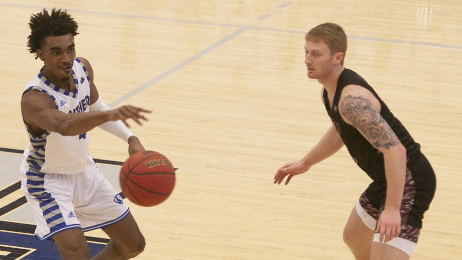 Eastern guard Marvin Johnson throws a pass toward the sideline in a game against Eastern Kentucky in Lantz Arena Jan. 16. Johnson scored 20 points and the Panthers lost 93-85 in overtime.