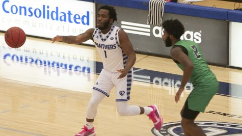 Eastern senior guard Kashawn Charles makes a pass to his right in a game against Chicago State in Lantz Arena on Dec. 3, 2020.
