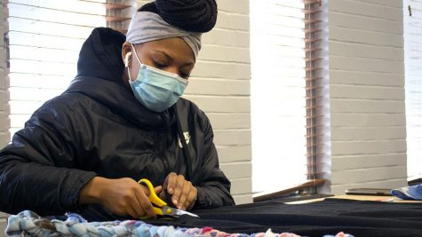 Cyan Carter, a sophomore psychology major and double minor in services and entrepreneurship, spends her time Wednesday afternoon making no-sew blankets for a local community charity.