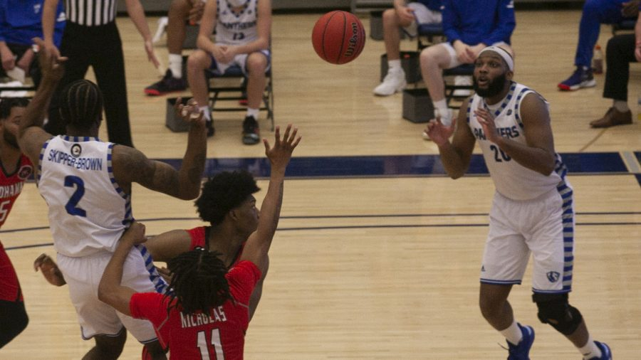 Eastern forward Jordan Skipper-Brown passes to forward Sammy Friday IV in the second half against Southeast Missouri Feb. 25 in Lantz Arena. Skipper-Brown scored 20 points and Friday IV added 15.