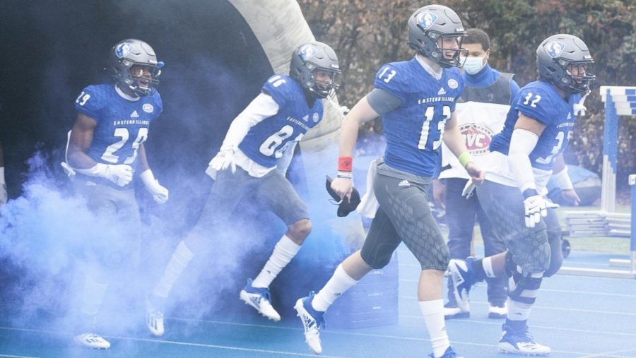 Members of the Eastern football team run out of the tunnel at O'Brien Field prior to the Panthers' game against Southeast Missouri Sunday afternoon. It was the first game in more than 15 months for the Panthers, who lost to the Redhawks 47-4