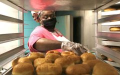 Marschelle McCoy, the office manager at the biological sciences department and owner of Revival City Doughnuts, makes doughnuts Friday morning at Revival City Doughnuts. She said she loves making people happy with her food. McCoy said that their motto is,