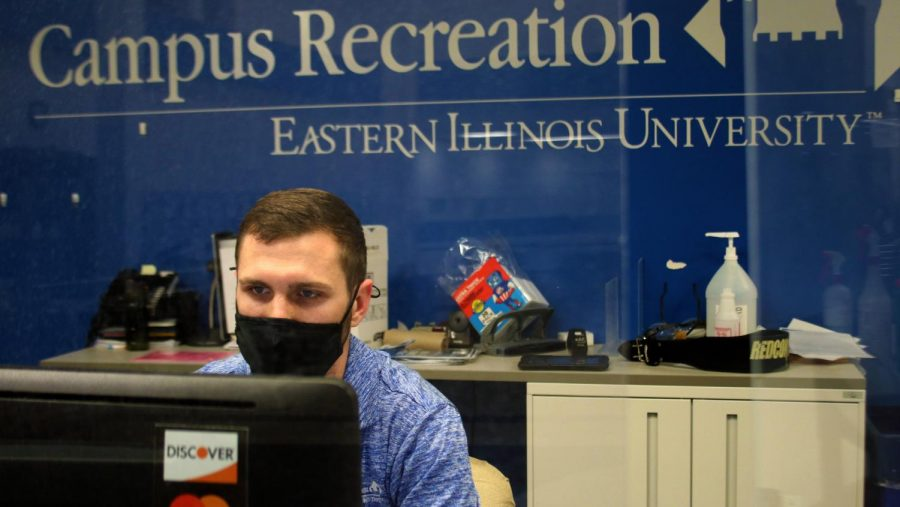 Trey Grubert, a second-year sports administration grad student, works the front desk at the Student Recreation Center. The front desk monitors student employees and enforces safety guidelines although, Grubert says,