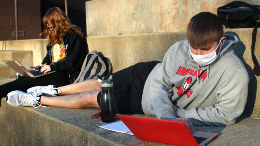 Sydney Cacioppo, a senior majoring in English education, and Grant Johnson, a senior majoring in finance, spent their Tuesday afternoon studying and working on homework on the Doudna steps. Cacioppo said