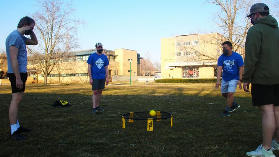 Patrick Mallaney (left), a freshman physics and astronomy major, Mason Bonds (left center), a freshman engineering technology major, Michael Barth (right center), a sophomore finance major, and Jack Drueke (right), a sophomore construction management major, enjoy the nice weather by playing spike ball in the south quad.