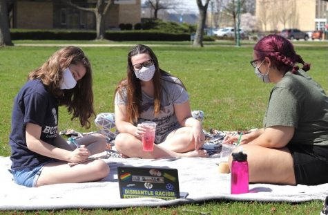 Katie Webb, a junior english major, Jaclyn Thomas, a junior communication major, and Katryna Wilkes, a junior political science major sit on the south quad listening to music and doing sudoku puzzles while enjoying the weather Sunday.