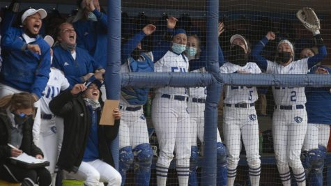 Members of the Eastern softball team celebrate in the dugout during the first game of a doubleheader March 13 against Belmont. The Panthers won the game 12-6.