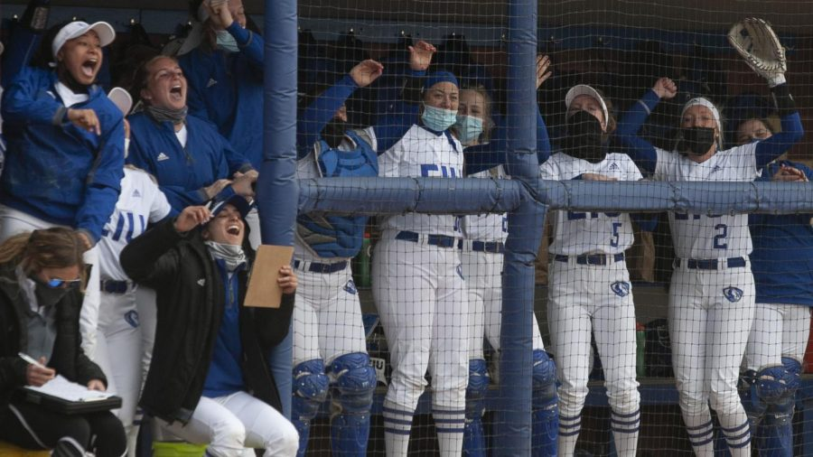 Members+of+the+Eastern+softball+team+celebrate+in+the+dugout+during+the+first+game+of+a+doubleheader+March+13+against+Belmont.+The+Panthers+won+the+game+12-6.