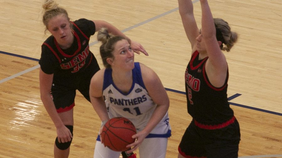 Eastern forward Abby Wahl battles with two opponents in below the basket in a game against Southeast Missouri Feb. 25 in Lantz Arena. Wahl had 10 points and 7 rebounds in the game, which Eastern won 65-57.