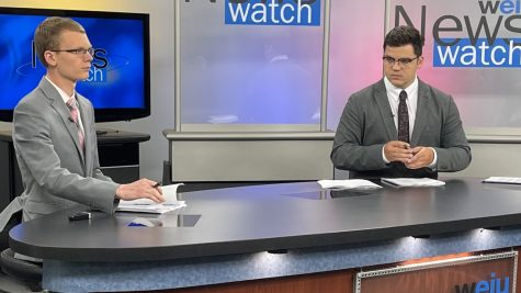 Eastern senior Everett Lau (left) and junior Stephen Elmore prepare to go on air for News Watch on WEIU on Wednesday evening. News Watch is broadcast every weekday at 5:30 p.m.