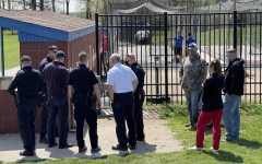 Members of the University Police Department, Charleston Police Department and Charleston Fire Department stand at Coaches Stadium after a groundskeeper discovered embryonic remains. It has yet to be determined if those remains are human or another species.