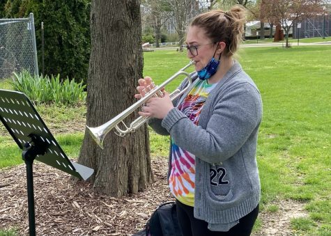 Mikayla Ruot, a senior majoring in music education, practices outside the Doudna Fine Arts Center for her trumpet lessons. Ruot explained that she has weekly lessons to learn new concepts which prepare her for performances at the end of the semester.