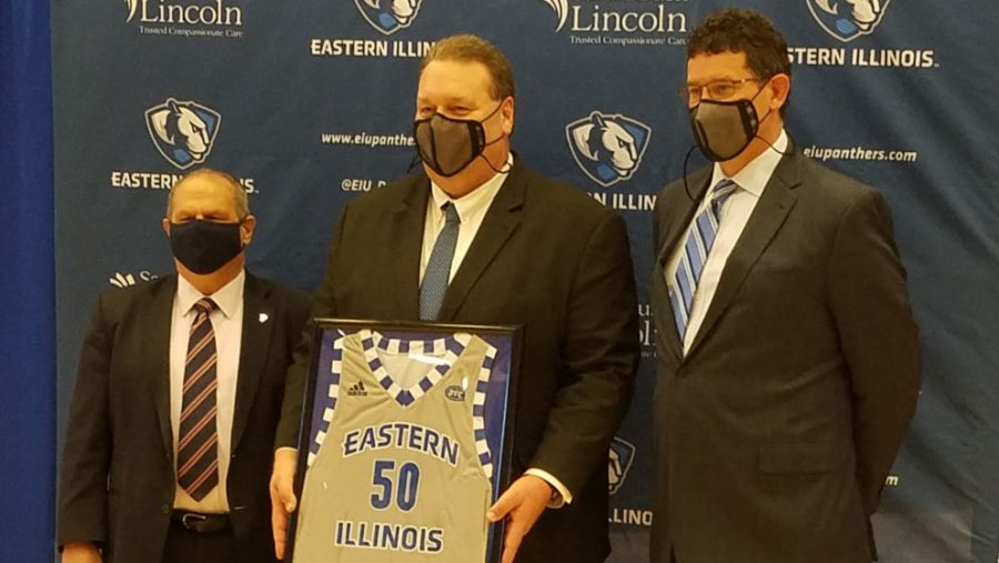 Eastern President David Glassman (left) and Athletic Director Tom Michael (right) pose with new men's basketball head coach Marty Simmons after his introductory press conference in Lantz Arena Thursday afternoon.