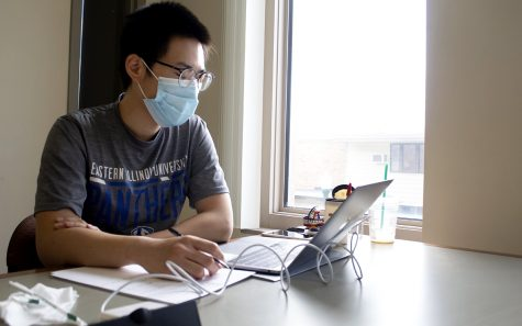 Mingze Gao, a graduate student studying biology, reviews previous class materials to prepare for grad school in the fall in Booth Library Tuesday afternoon. He said he