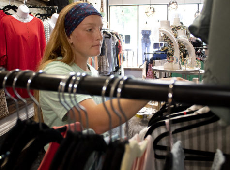 Kaitlyn Wilson, a junior in high school, works at Plush Boutique in the square Tuesday afternoon. Wilson said she loves working at the boutique and wants to own a small boutique someday. She added that she