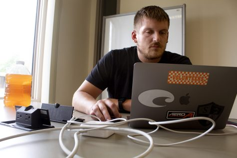 Ryland Ard, a senior majoring in engineering tech, works on summer classes in Booth Library Tuesday afternoon. Ard said he