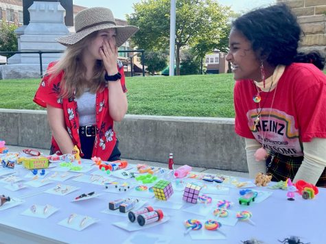 Charleston residents Elaina Sutula and Nethmi Periyannan sell earrings at the Coles County Courthouse. The earrings were made of toys, office supplies and miniatures.
