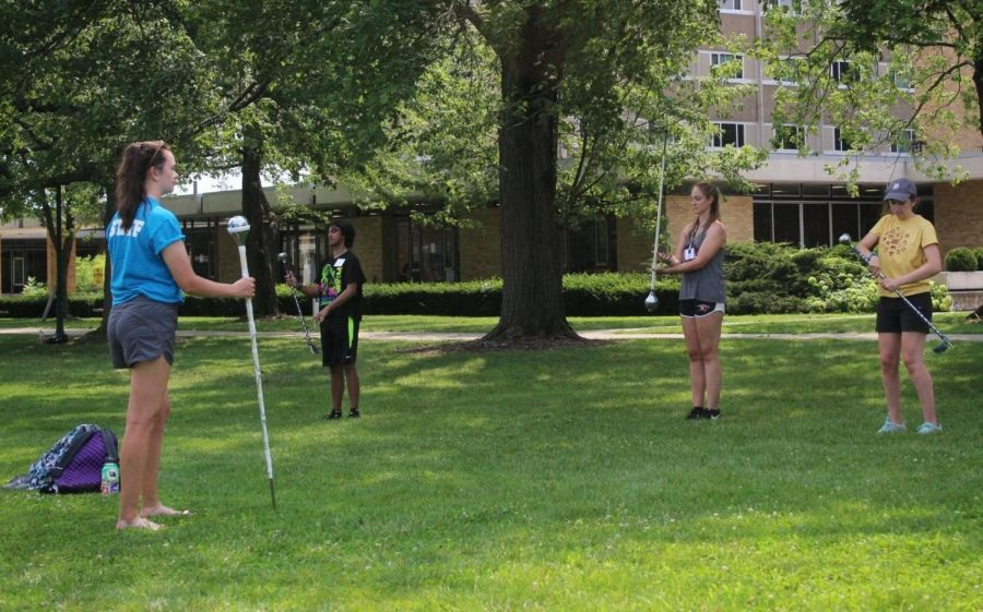 A staff member for the Smith Walbridge drum major clinic teaches students how to spin a mace on Tuesday afternoon in the South Quad.
