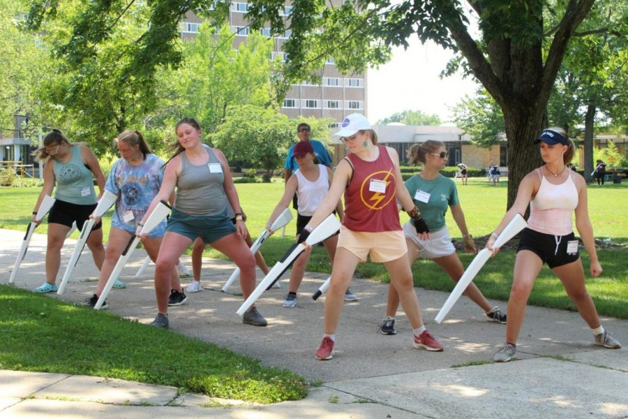The beginners rifle break-out group practice a short routine during the Smith Walbridge Clinics in the South Quad.