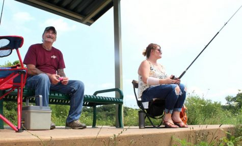James Willenborg and Jennifer Odell wait for fish to bite their lines at Lake Charleston.  Odell said they havent gotten any bites or caught any fish Wednesday afternoon.