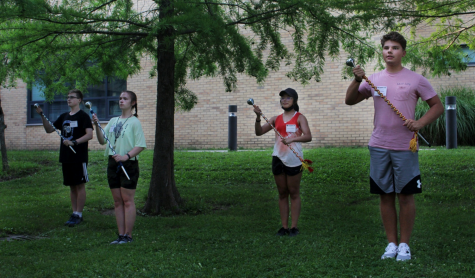 Campers at the Smith Walbridge drum major clinic practice their group salute Wednesday afternoon.