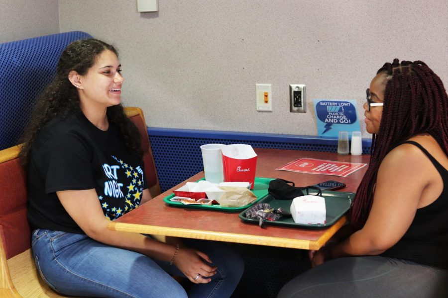 Leila Lawson, a senior biology major, enjoys lunch while she eats Chick-fil-A with her friend, Sihile Mwalongo, a senior economics major. They both say the union is their favorite place to eat on campus.