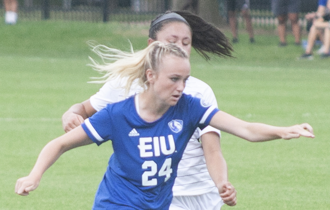 Eastern+sophomore+midfielder+Cam+Korhorn+dribbles+by+an+Illinois+Springfield+defender+in+a+match+Aug.+22+at+Lakeside.+The+Panthers+won+the+match+3-0+for+their+first+win+of+the+season.+