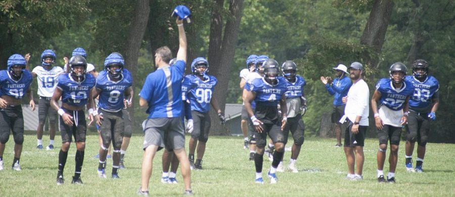 Eastern head football coach Adam Cushing (holding hat) coaches the team through up downs at practice Aug. 20. The Panthers will travel to Terre Haute Saturday to open the 2021 season against Indiana State.