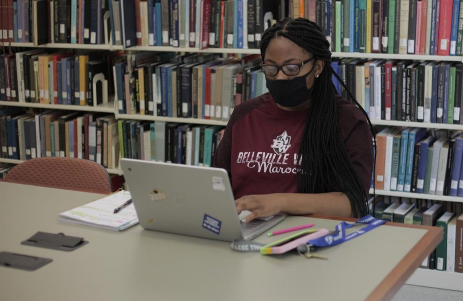 Sheyenne Byrd, a freshman pre-nursing major, works on an assignment for her Health Citizenship course at Booth Library. The stacks in Booth Library have reopened for the Fall semester after being closed to student browsing during part of the COVID-19 pandemic.