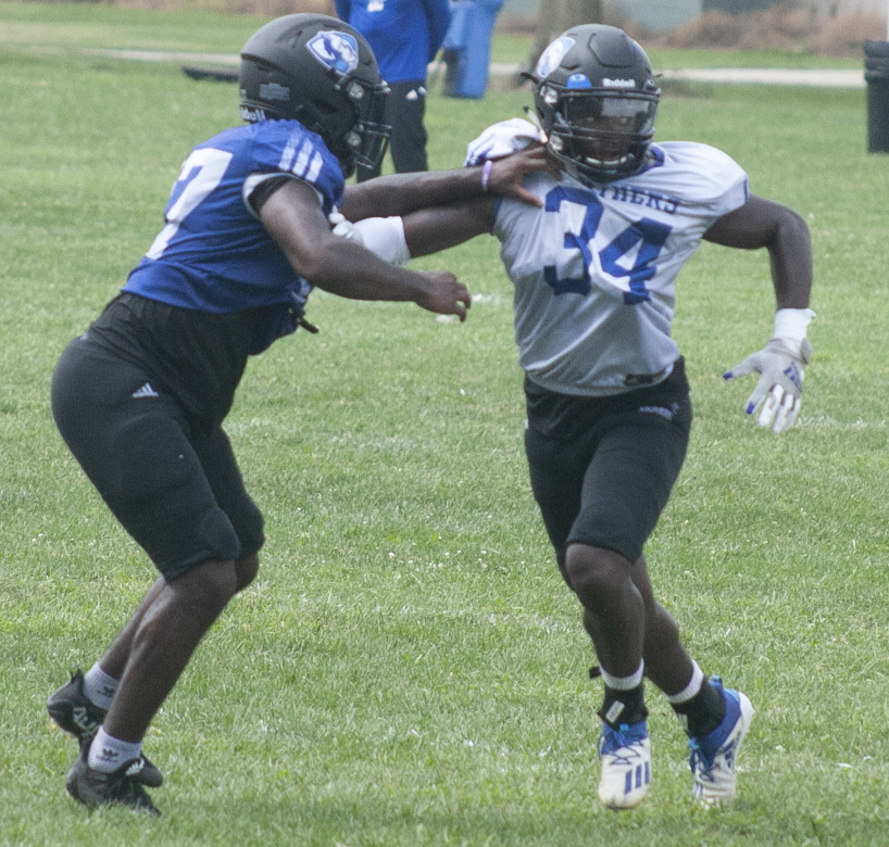 Eastern+freshman+safety+Josh+St.+Preux+runs+a+drill+with+a+teammate+during+practice+on+Aug.+20.+