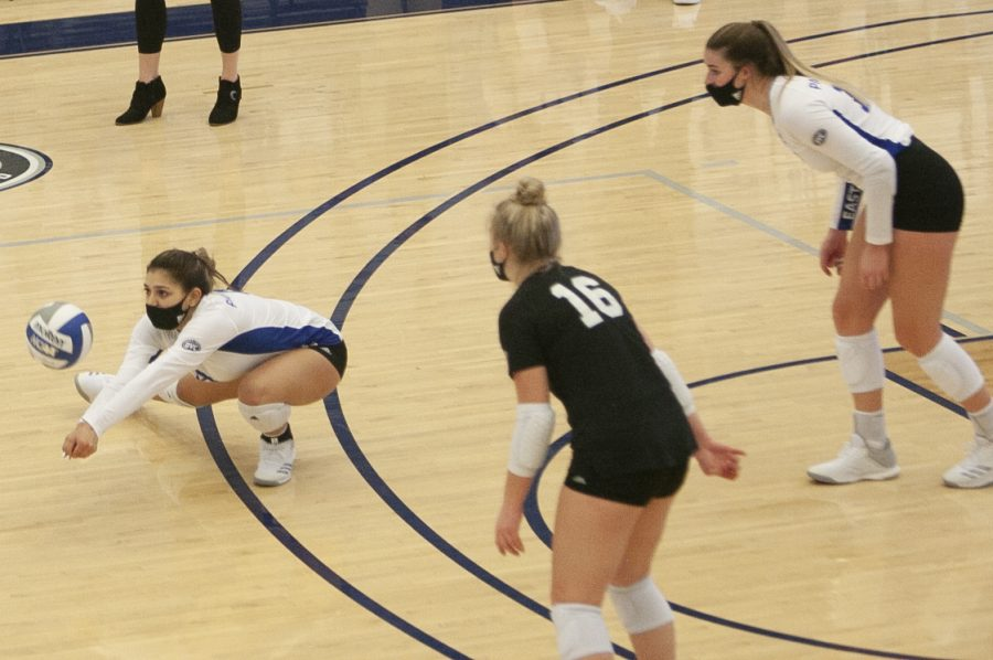 Eastern+libero+Christina+Martinez+Munoz+lunges+to+her+left+to+return+a+serve+in+a+match+against+Feb.+7+against+Morehead+State+in+Lantz+Arena.+Martinez+Mundo+recorded+10+digs+in+the+match%2C+which+Eastern+lost+3-1.+