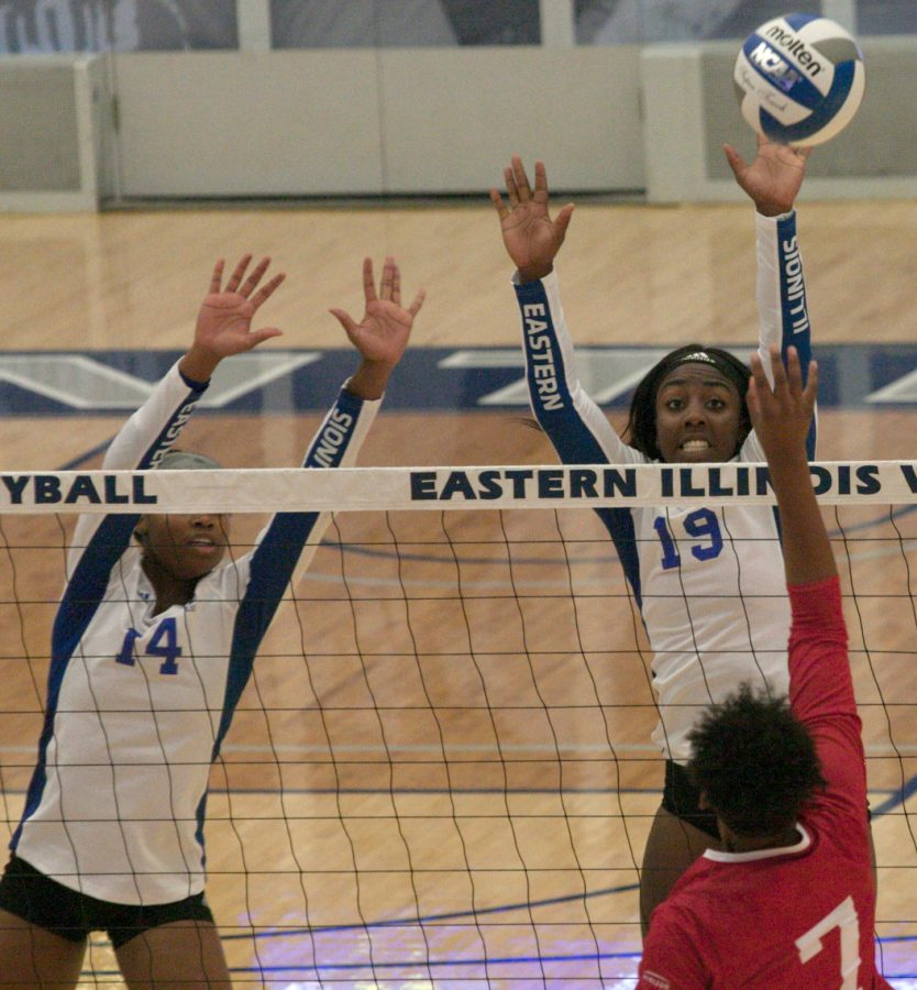 Eastern middle hitter Kameryn Sillmon (14) and outside hitter Danielle Allen (19) jump in an attempt a block against IUPUI on Aug. 27 in Lantz Arena. Allen led the team with 14 kills in the match, which Eastern 3-0.