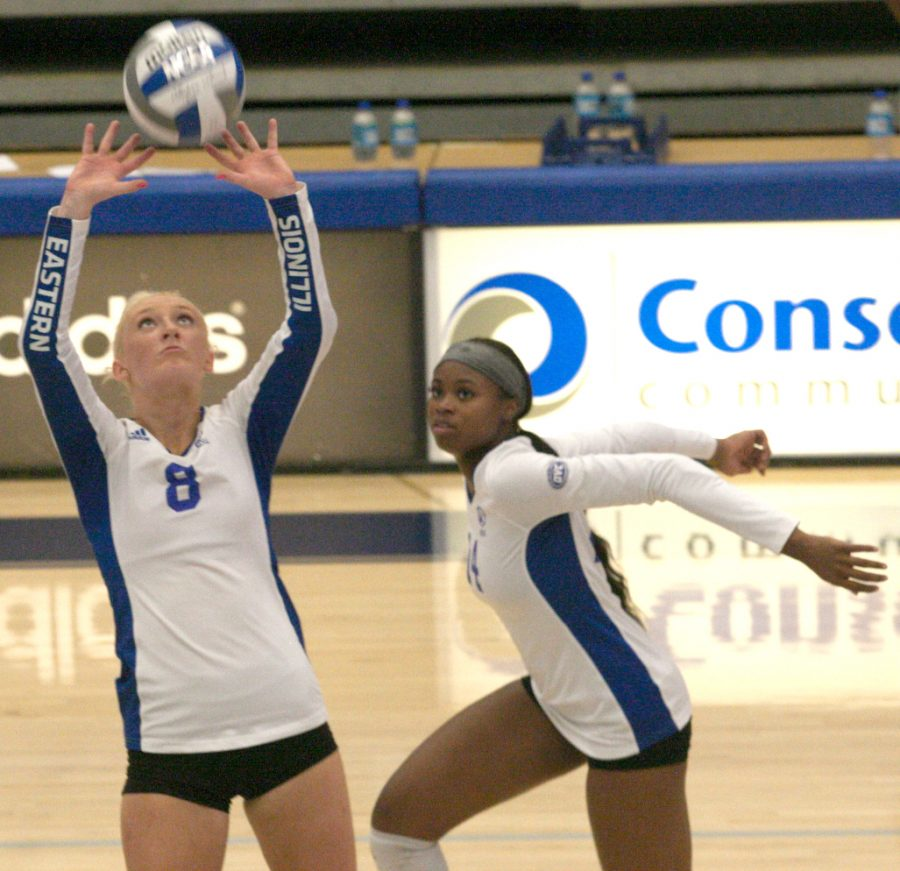 Eastern setter Summer Smith (left) sets up middle hitter Kameryn Sillmon for a kill attempt against IUPUI Aug. 27 in Lantz Arena. Smith had 25 assists in the match, which Eastern won 3-0.