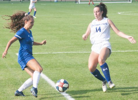 Eastern sophomore forward Serra Pizano (left) battles an Indiana State player for possession in a match on Aug. 19 at Lakeside Field. Pizano recorded a shot in the match, which Eastern lost 3-1.