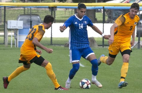 Eastern redshirt-junior midfielder Munir Sherali tries to keep the ball away from two Milwaukee players in a match Aug. 30 at Lakeside Field. The score was tied 0-0 at halftime when severe storms forced the match to be declared a no-contest.