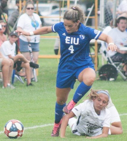 Eastern defender Eva Munoz pushes by an Illinois Springfield player in a match Aug. 22 at Lakeside Field. Eastern won the match 3-0.