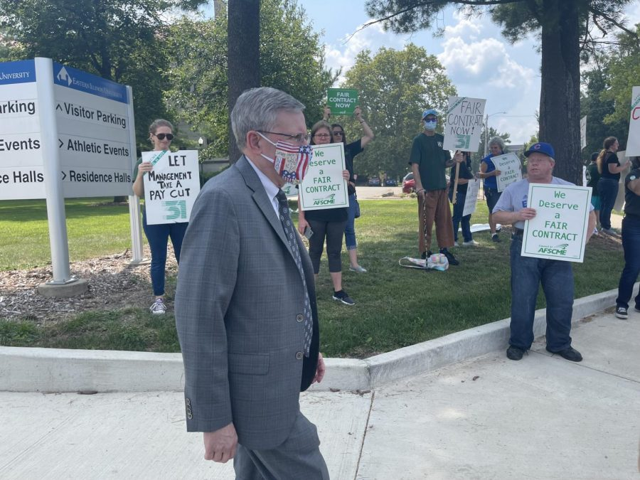 Eastern Treasurer Paul McCann walks down Lincoln Avenue, crossing the paths of protesters seeking a contract for members of The American Federation of State, County and Municipal Employees Local 981.
