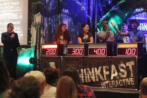 Students play a preliminary round of trivia during Up All Night in the University Ballroom Aug. 19, 2016.