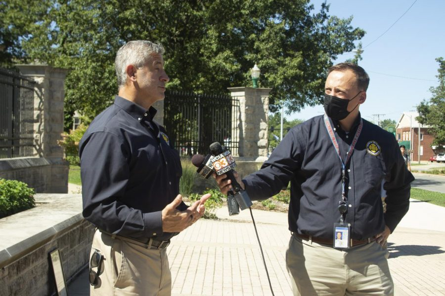J.C. Fultz, public information officer, and Matt Perez, fire marshall, answer questions after the campus fire safety presentation on Wednesday morning.