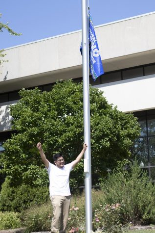 Luis Paniagua, a senior graphic design major, and the recruitment chair and secretary for Alpha Psi Lambda, shows his excitement after raising the Latino Heritage Flag.