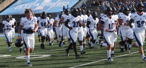 The Eastern football leaves the field following warmups for the season