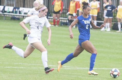 Eastern junior forward Michaela Danyo pushed passed a defender in a match against Illinois Springfield Aug. 22 at Lakeside Field. Danyo scored a goal in the match, which Eastern won 3-0.