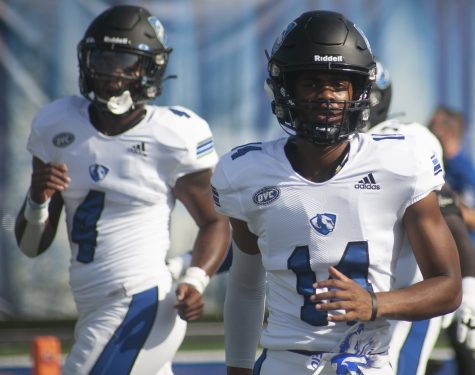 Wide receiver Kirk Pinkston Jr. (14) and defensive back Kobe Rodgers take the field before the Panthers 26-21 loss to Indiana State Aug. 28.