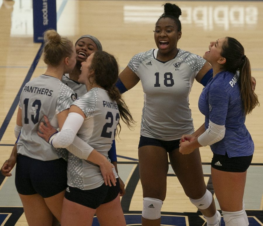 The Eastern volleyball team celebrates a kill from sophomore outside hitter Ella Collins (13) in a match against Northern Illinois Sept. 2 in Lantz Arena. Collins had 4 kills in the match, which Eastern won 3-1.