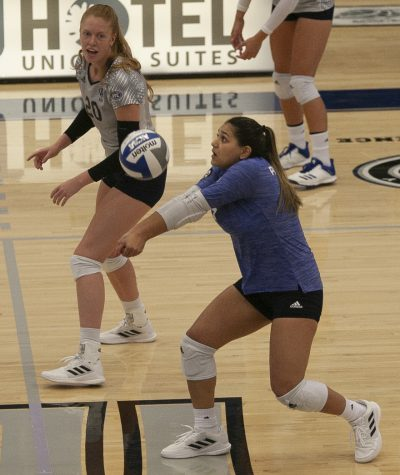 Eastern libero Christina Martinez Mundo receives a serve in a match against Northern Illinois on Sept. 2 in Lantz Arena. Mundo had 26 digs in the match, which Eastern won 3-1.
